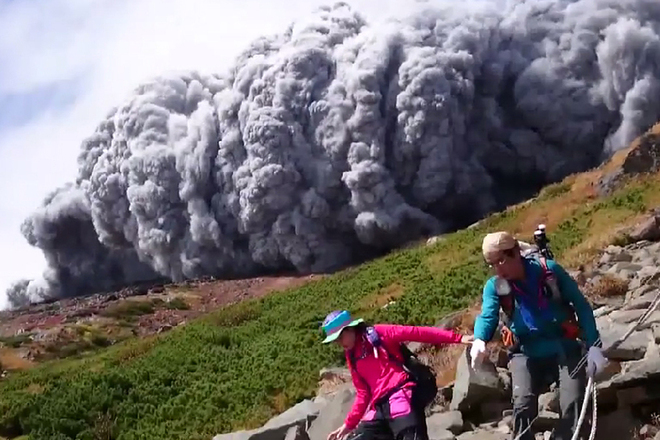 A hiker's dramatic video captured the scene as a huge cloud of ash poured down the side of Mt. Ontake in Japan Saturday